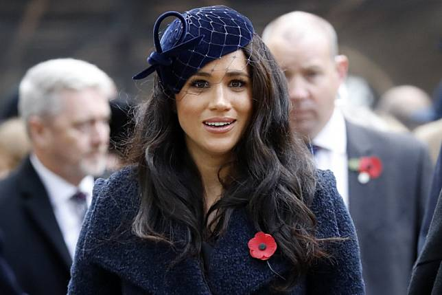 Meghan, Duchess of Sussex, leaves after paying her respects during a visit to the Field of Remembrance at Westminster Abbey in central London on November 7, 2019.