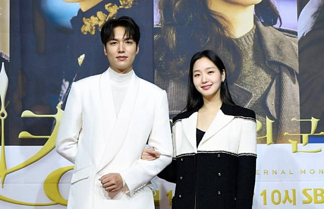 Lee Min-ho (left) and Kim Go-eun pose for photos during a press conference for new SBS drama series 'The King: Eternal Monarch' on April 16, 2020.
