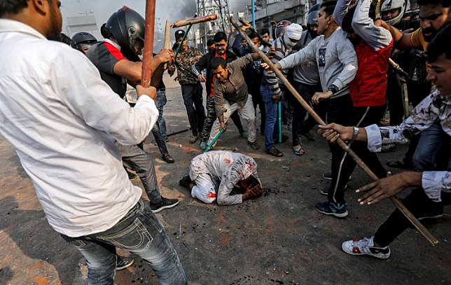 A group of men chanting pro-Hindu slogans beat Mohammad Zubair, 37, who is Muslim, during protests sparked by a new citizenship law in New Delhi, India, on Feb. 24.