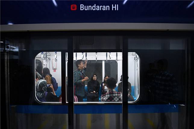 Members of the public ride the Jakarta MRT on March 12, the first day of the trial run for the new mass transit system.