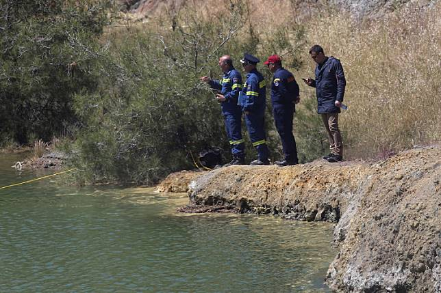 Rescuers stand next to a lake during a search operation for a six-year-old missing girl at the Xiliatos dam in Cyprus, April 22, 2019.