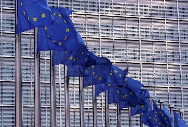 European Union flags fly outside the European Commission headquarters in Brussels, Belgium, Feb. 19, 2020.