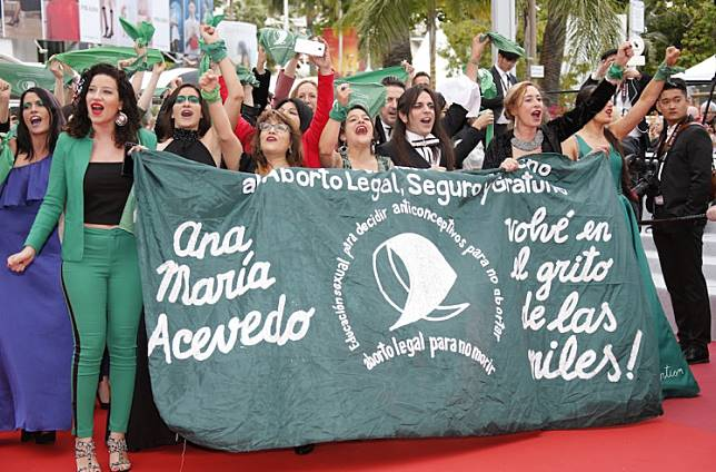 Women with green handkerchiefs demonstrate against the rejection of the law legalizing abortion in Argentina at the screening of the documentary film 'Que Sea Ley' (Let it be law) presented as part of special screenings in the 72nd Cannes Film Festival Cannes, France, on May 18, 2019.