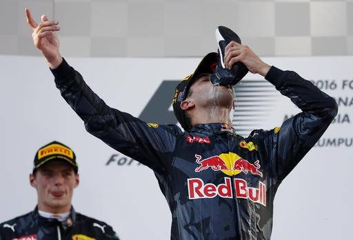 Red Bull driver Daniel Ricciardo of Australia drinks champagne from his shoe as he celebrates on the podium after winning the Malaysian Formula One Grand Prix at the Sepang International Circuit in Sepang, Malaysia, on Oct. 2, 2016.