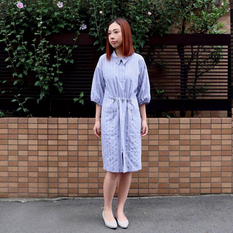 色織白條子,布料具有支理質感。 直身板型,着重腰部袋子細節,容易穿著。