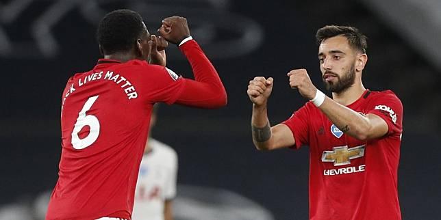 Paul Pogba turut merayakan gol Bruno Fernandes ke gawang Tottenham (c) AP Photo