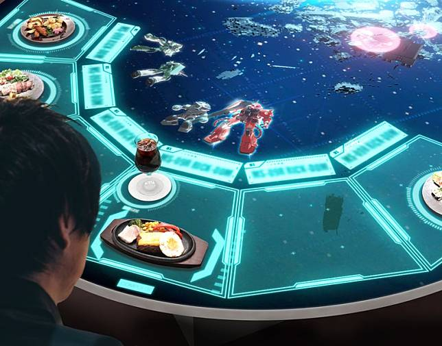 Zeon's Diner TOKYO中間位置有一張巨型餐枱,桌面是屏幕,當食物上枱時屏幕會放映MS的戰鬥場面。(互聯網)