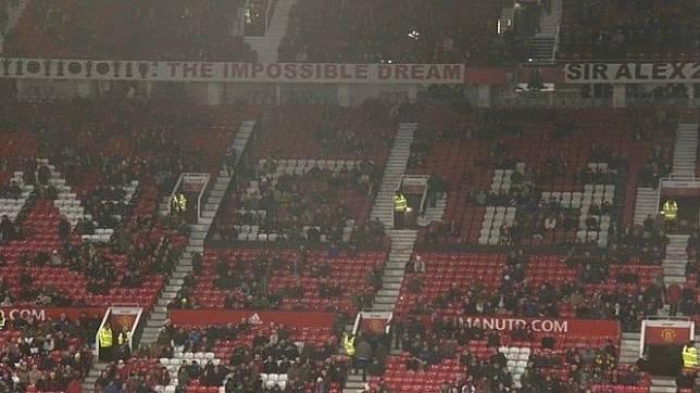 Ilustrasi suporter Manchester United.