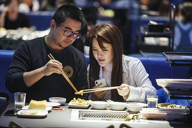 China's restaurant industry is booming as young professionals stay hungry amid trade war, slowing economy