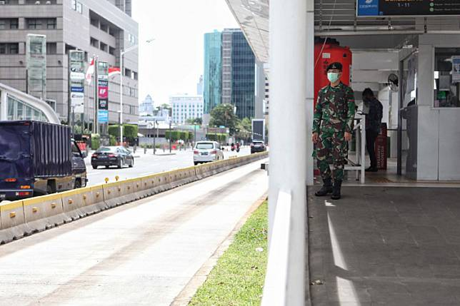 An Indonesia military staff stands guard at Bundaran HI MRT station in Jakarta, on Tuesday, May 26, 2020.