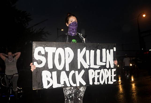 MINNEAPOLIS, MN - MAY 26: Protesters demonstrate against the death of George Floyd outside the 3rd Precinct Police Precinct on May 26, 2020 in Minneapolis, Minnesota. Four Minneapolis police officers have been fired after a video taken by a bystander was posted on social media showing Floyd's neck being pinned to the ground by an officer as he repeatedly said,