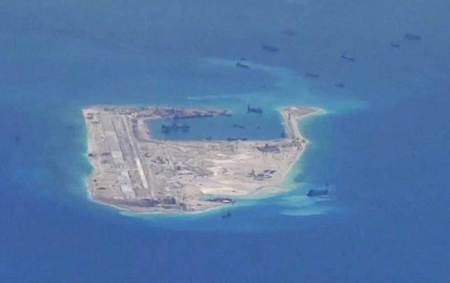 Chinese dredging vessels are purportedly seen in the waters around Fiery Cross Reef in the disputed Spratly Islands in the South China Sea in this still image from video taken by a P-8A Poseidon surveillance aircraft provided by the United States Navy May 21, 2015.The United States this week hardened its position on the South China Sea, where it has accused China of attempting to build a