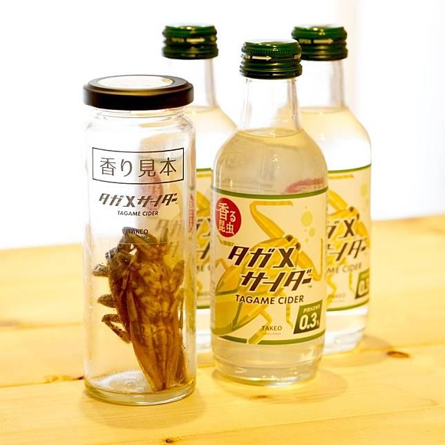 昆蟲食物生產商TAKEO剛推出的新飲品Tagame Cider,特別之處是內含0.3%的狄氏大田鱉精華。(互聯網)