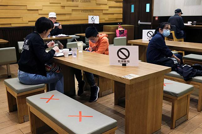 Social distancing marks are seen on chairs at a restaurant, following the COVID-19 outbreak, in Hong Kong, China March 29, 2020.