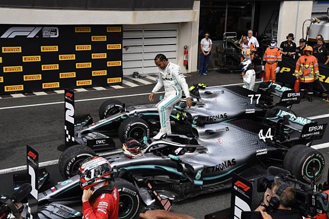 Winner Mercedes' British driver Lewis Hamilton celebrates in the pits after the Formula One Grand Prix de France at the Circuit Paul Ricard in Le Castellet, southern France, on June 23, 2019.