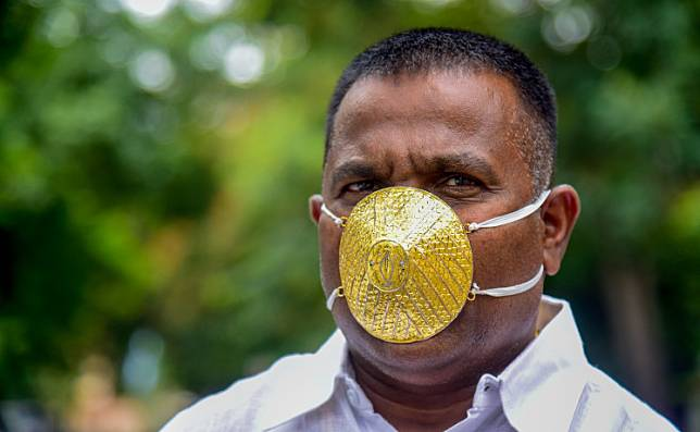 Businessman Shankar Kurhade wears a facemask made of gold and being worth 289,000 rupees amid concerns over the COVID-19 coronavirus outbreak, in Pune on July 4, 2020.
