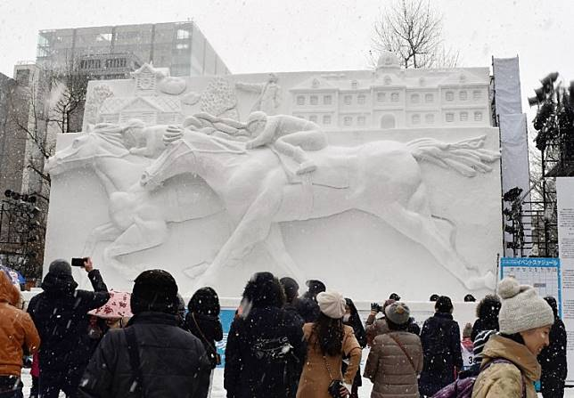 People watch the horse racing snow statue during the opening day of eight-day Sapporo Snow Festival in Sapporo on Feb. 4, 2019.Saudi Arabia this week hosts the world's richest horse race, with $20 million in cash prizes on offer in the latest international sports extravaganza designed to boost its battered global image.