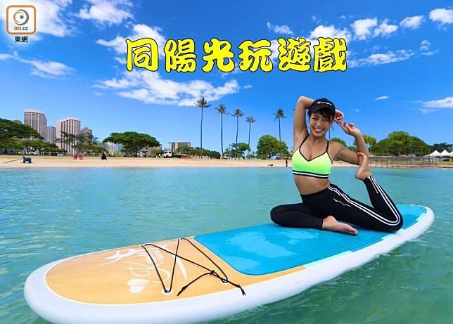 「日本寫真界黑鑽石」橋本梨菜最近到夏威夷玩樂,仲大玩滑浪板瑜珈添。(互聯網)