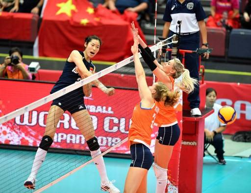 This file photo taken on September 27, 2019 shows China's Zhu Ting (left) spiking the ball past Netherlands' Nicole Koolhaas (center) and Laura Dijkema (right) during a match of the FIVB Women's World Cup volleyball between China and Netherlands in Osaka. - Zhu Ting stands tall in China -- and not just because she is a towering 1.98 meters . The 25-year-old farmer's daughter has emerged from a poor village life to become a totem of the sporting ambitions of the world's most populous country.