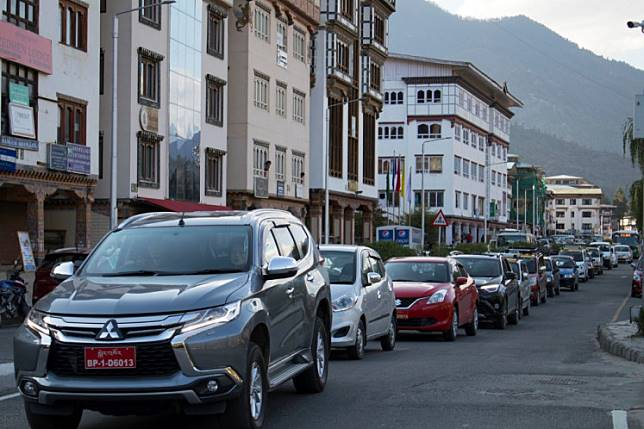 This photo taken on April 19, 2019 shows traffic backed up on a road in Bhutan's capital Thimphu.