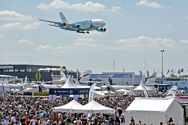 An Airbus A380 of Portuguese company Highfly prepares to land after its flying display at the International Paris Air Show on Saturday at Le Bourget Airport near Paris.
