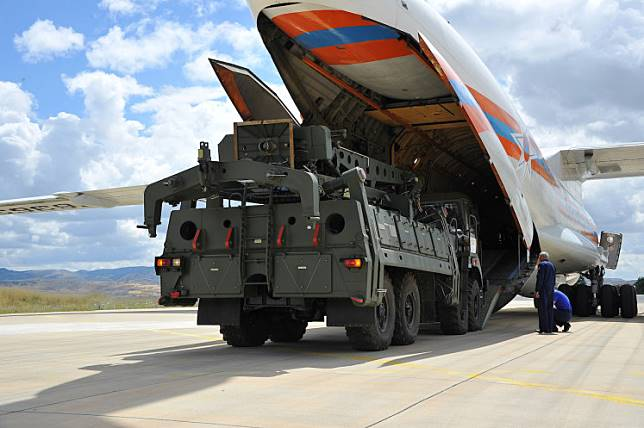 First parts of a Russian S-400 missile defense system are unloaded from a Russian plane at Murted Airport, known as Akinci Air Base, near Ankara, Turkey, July 12, 2019.