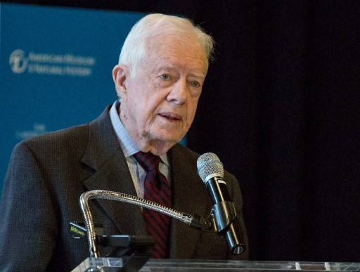 In this file photo taken on Jan. 12, 2015, former US President Jimmy Carter speaks at a press conference to open a new exhibit at the American Museum of Natural History in New York City. - Carter said on June 3, 2020, he was