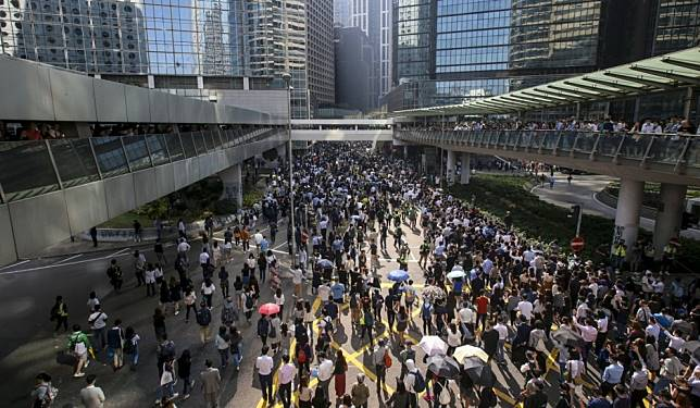 Hong Kong protests: lunchtime demonstrations extend across city with hundreds of people blocking roads