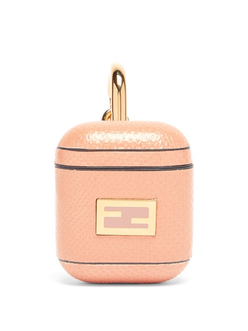 Fendi - Fendi's blush pink AirPods case is adorned with the iconic FF logo plaque, first designed by the late Karl Lagerfeld in 1965. It's made in Italy from plastic that's coated with snakeskin and hangs from a gold lobster clasp.