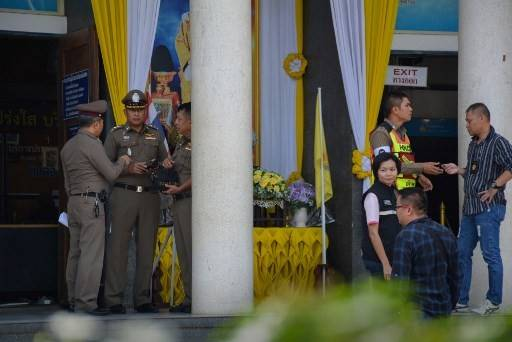 Thai Royal Police officers and investigators are seen outside the Chantaburi provincial court after shooting incident on November 12, 21019. Three people were killed in a shootout at a Thai courtroom on November 12, during a hearing into an inheritance dispute, according to police, who said two of the victims were lawyers. The gunman opened fire on the opposing side in the dispute in Chanthaburi provincial court before a guard shot back and fatally wounded him.
