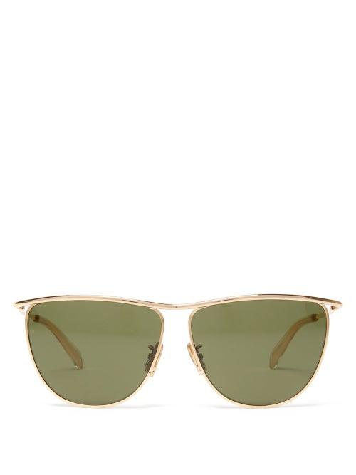 Celine Eyewear - Celine's gold Andy sunglasses lend a directional edge to the classic aviator silhou