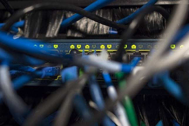 Network cables are seen going into a server in an office building in Washington, DC, on May 13, 2017.