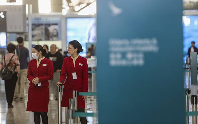 China coronavirus: after union fury, Hong Kong's Cathay Pacific Airways will let staff wear surgical masks on flights