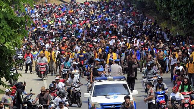 Papuan protesters demonstrate in Jayapura, Papua on Monday, 19 August 2019. Television footage showed a group of about 150 people marching on the streets in Manokwari, as well as footage of smoke billowing from a parliament building. Papua Governor Lukas Enembe said Papuans were angry because of