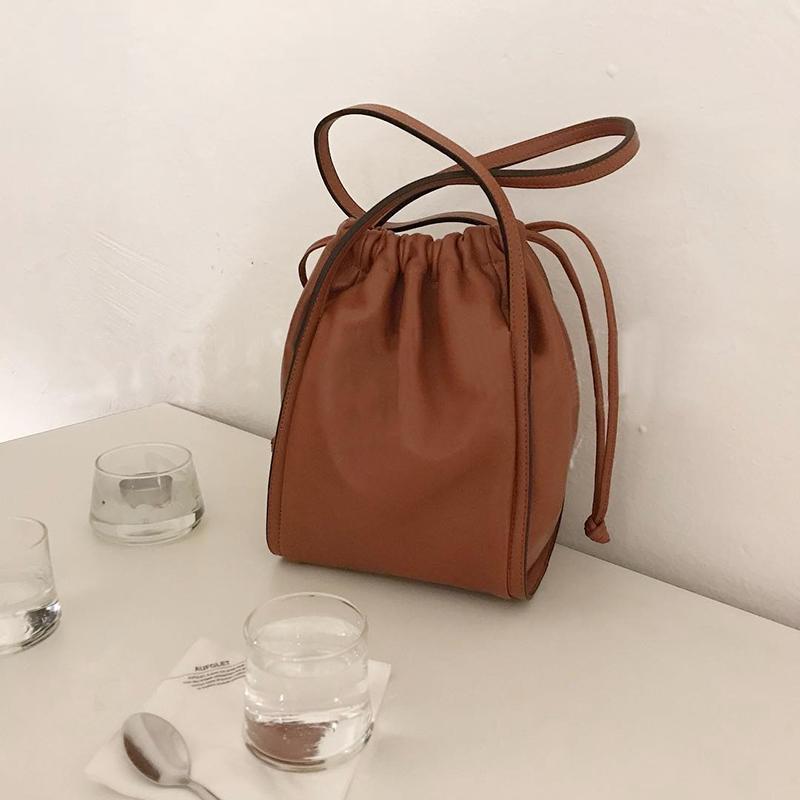 韓國春夏新款復古手提抽帶水桶包簡約女包ins休閒百搭潮手拎包