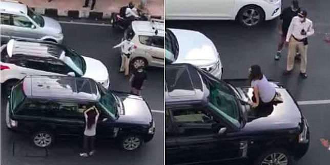 Perempuan naik kap mobil (Cartoq)