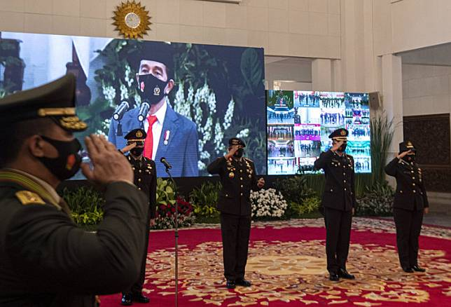 President Joko Widodo (on screen) leads a ceremony to commemorate the National Police's 74th anniversary at the State Palace in Central Jakarta on July 1.