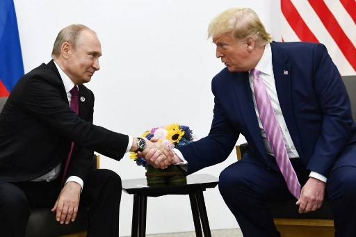 In this file photo US President Donald Trump  attends a meeting with Russia's President Vladimir Putin during the G20 summit in Osaka on June 28, 2019. A Russian military plane carrying medical equipment has departed for the United States, the defense ministry in Moscow said Wednesday, as the Kremlin flexes its soft power amid the coronavirus pandemic.