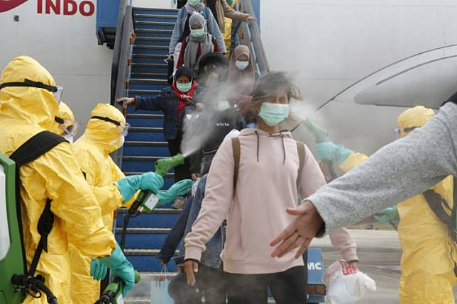 Medical officers spray disinfectant liquid on Indonesian citizens (WNI) from Wuhan, China on arrival at Hang Nadim Airport, Batam, Riau Islands, om Feb.2. Airlines are turning to some of the world's hardest-hitting disinfectants, capable of stopping everything from sexually transmitted diseases to the MRSA superbug, in the fight against the coronavirus.
