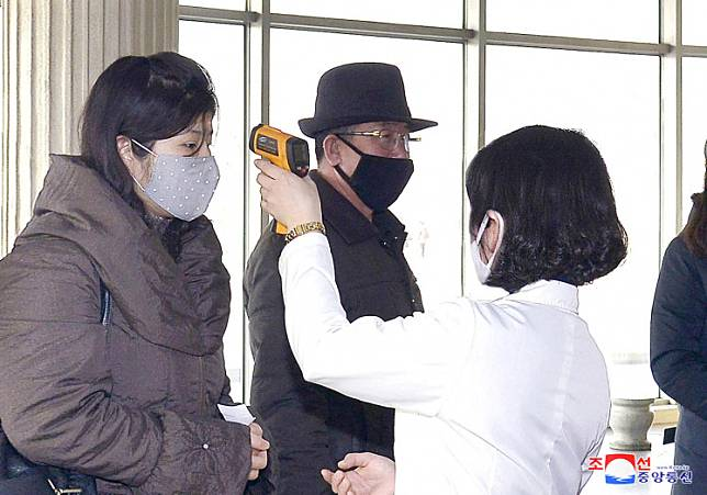 Volunteers carry out temperature screening during an anti-virus campaign in Pyongyang, North Korea in this image released by North Korea's Korean Central News Agency (KCNA) on March 4, 2020.