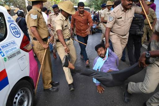 A student member of the Campus Front of India is taken into police custody while resisting arrest for protesting in the prohibited, high security zone near the Karnataka Governor's house, also known as the Raj Bhavan, in Bangalore on February 27, 2020. The students were protesting against the recent unrest in wake of violent clashes between protesters and supporters of India's controversial citizenship law in New Delhi that have claimed so far claimed lives of 33 people in the capital in the past four days.