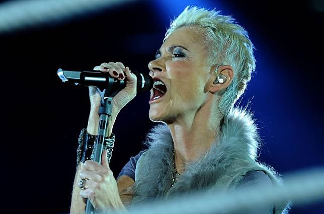 This file photo taken on March 19, 2011 shows Swedish singer Marie Fredriksson of the pop group Roxette performing in Cologne, western Germany. As it was announced on December 10, 2019, Fredriksson died on December 9, 2019 at the age of 61.