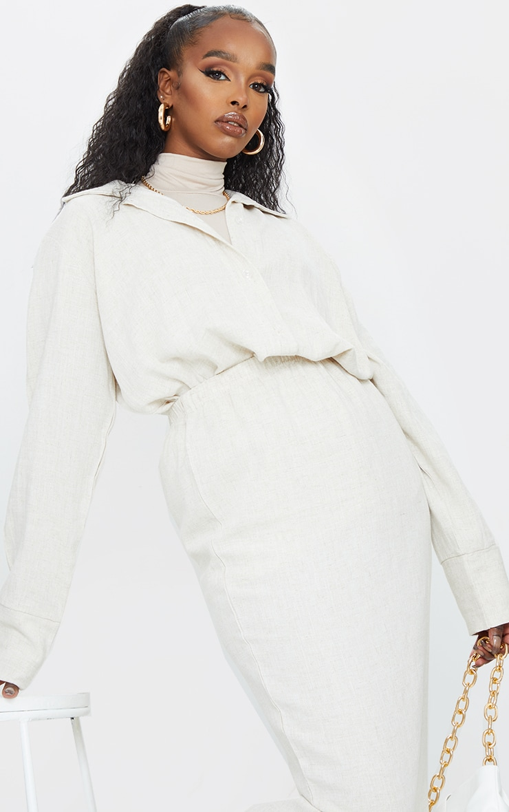 Stone Woven Longline Shirt nAdd some neutrals to your look with this shirt doll Featuring a stone wo