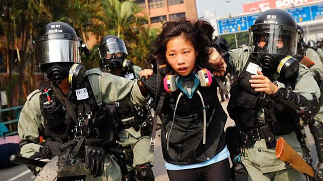 A protester is detained by riot police while attempting to leave the campus of Hong Kong Polytechnic University (PolyU) during clashes with police in Hong Kong, China November 18, 2019. Hong Kong police laid siege to a university on Monday (November 18), arresting anti-government protesters while firing rubber bullets and tear gas to pin back them back. REUTERS/Thomas Peter