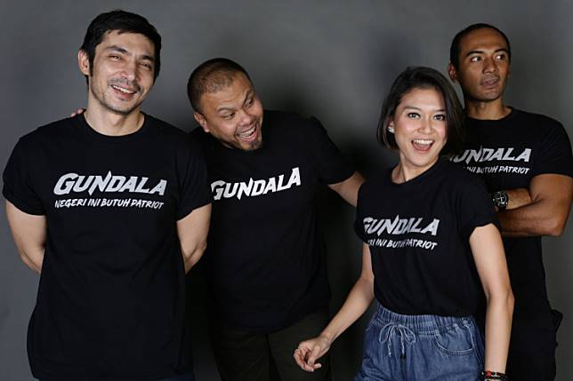 Actors Abimana Aryasatya, Marissa Anita and Ario Bayu of 'Gundala' pose with the film's director-slash-scriptwriter Joko Anwar.  The cast and crew were photographed at 'The Jakarta Post' during an interview on June 20, 2019