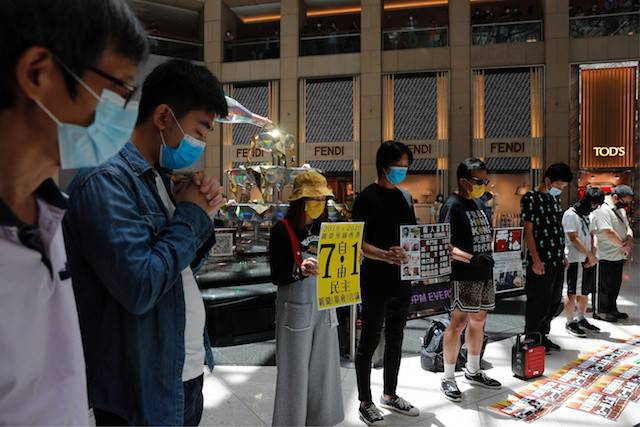 Pro-democracy protesters observe a minute of silence during a protest after China's parliament passes a national security law for Hong Kong, in Hong Kong, China June 30, 2020.