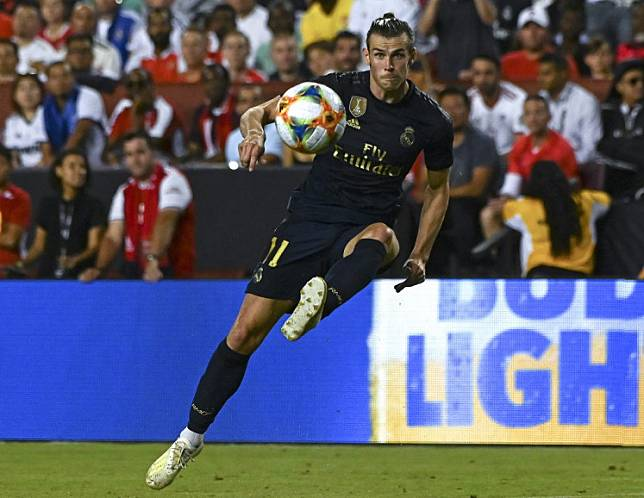 Real Madrid's Welsh forward Gareth Baleeth Bale controls the ball during the International Champions Cup football match between Real Madrid and Arsenal at FedExField in Landover, Maryland, on July 23, 2019.Bale's agent says the Real Madrid forward is unlikely to return to the Premier League because he wants to finish his career at the Bernabeu.