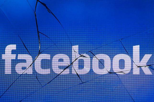 In this file photo taken in Paris on May 16, 2018 shows the logo of the social network Facebook on a broken screen of a mobile phone. Facebook on March 27, 2019 announced it will ban praise or support for white nationalism at the leading online social network and its image-centric messaging service Instagram.