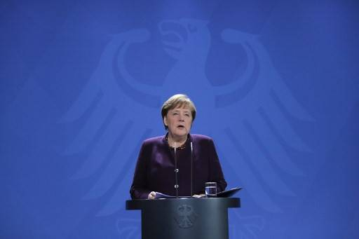 German Chancellor Angela Merkel makes a press statement on the spread of the coronavirus COVID-19 at the Chancellery, in Berlin on Monday.