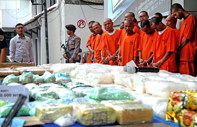 National Narcotics Agency (BNN) officers present  drug trafficking suspects to the press on May 21.